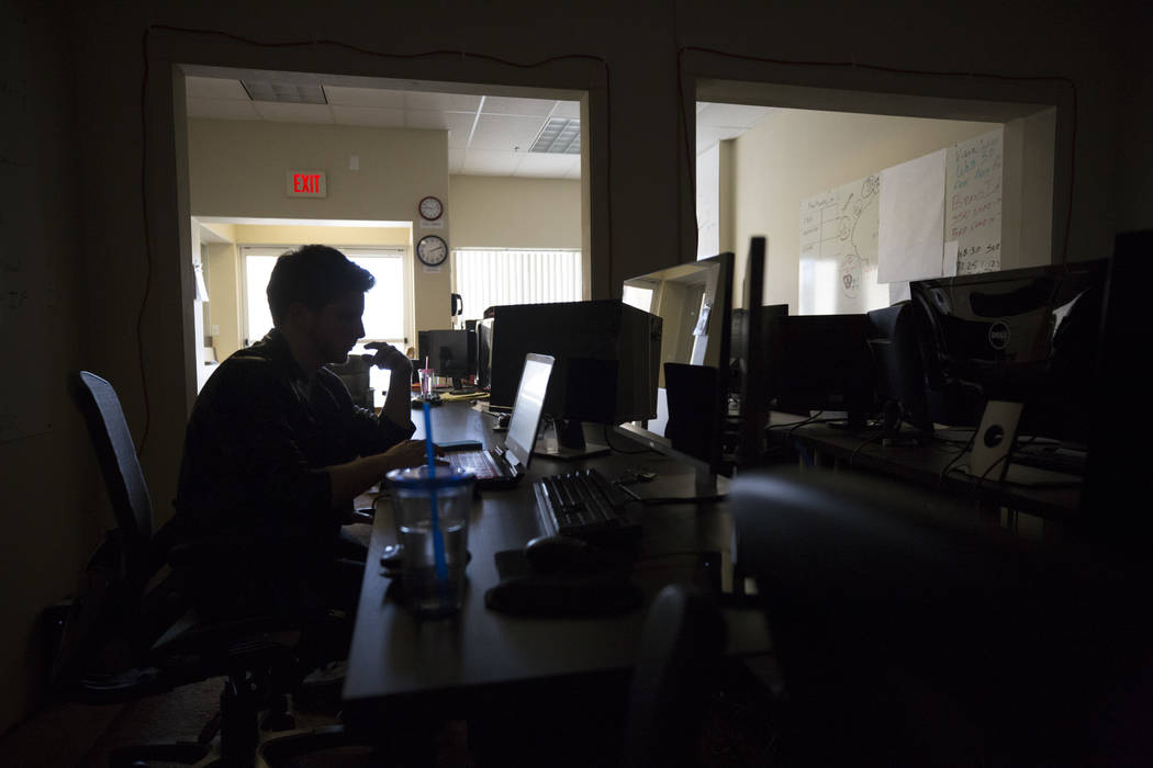 Adam Wozniak works on code at Cascade Financial Technology Corp.'s office in Las Vegas on Monday, March 12, 2018. Richard Brian Las Vegas Review-Journal @vegasphotograph