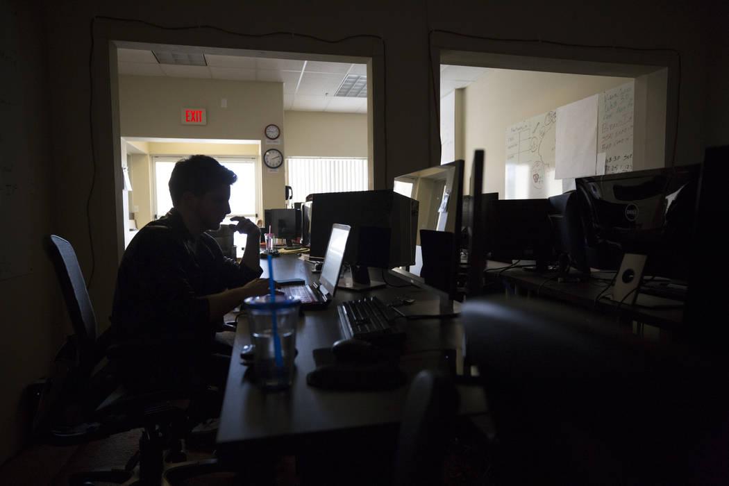 Adam Wozniak works on code at Cascade Financial Technology Corp.'s office in Las Vegas on Monday, March 12, 2018. Richard Brian Las Vegas Review-Journal @vegasphotograph