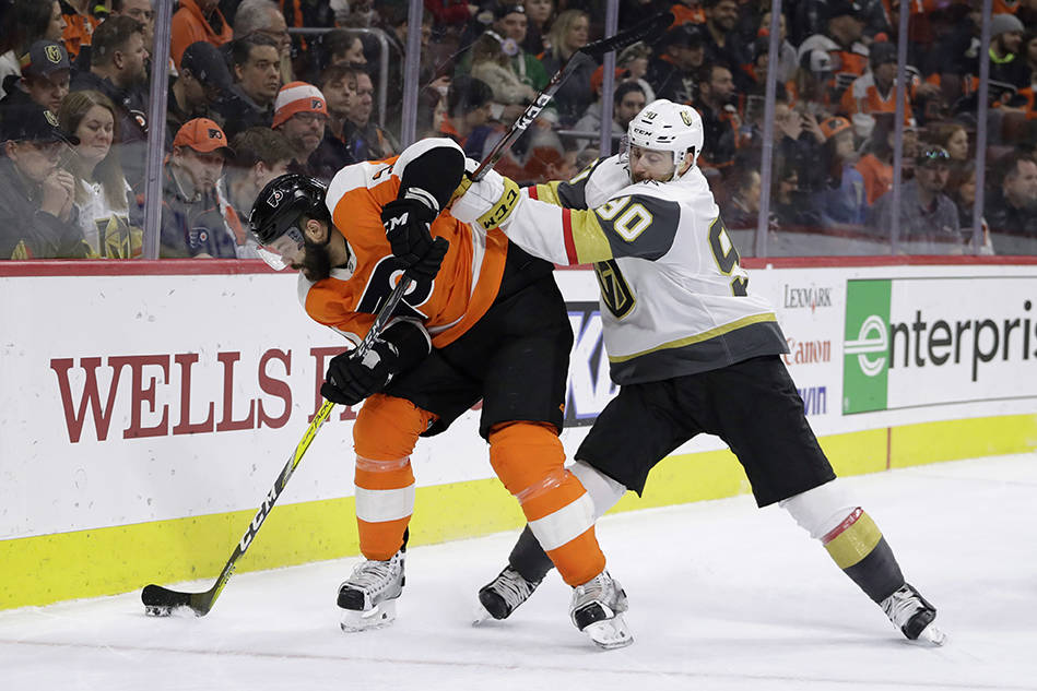 Vegas Golden Knights' Tomas Tatar, right, and Philadelphia Flyers' Radko Gudas battle for the puck during the third period of an NHL hockey game, Monday, March 12, 2018, in Philadelphia. (AP Photo ...