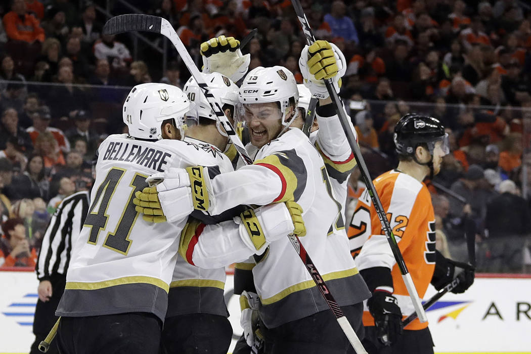 Vegas Golden Knights' Pierre-Edouard Bellemare (41), Ryan Carpenter (40) and Jon Merrill (15) celebrate past Philadelphia Flyers' Michael Raffl (12) after Carpenter's goal during the third period  ...