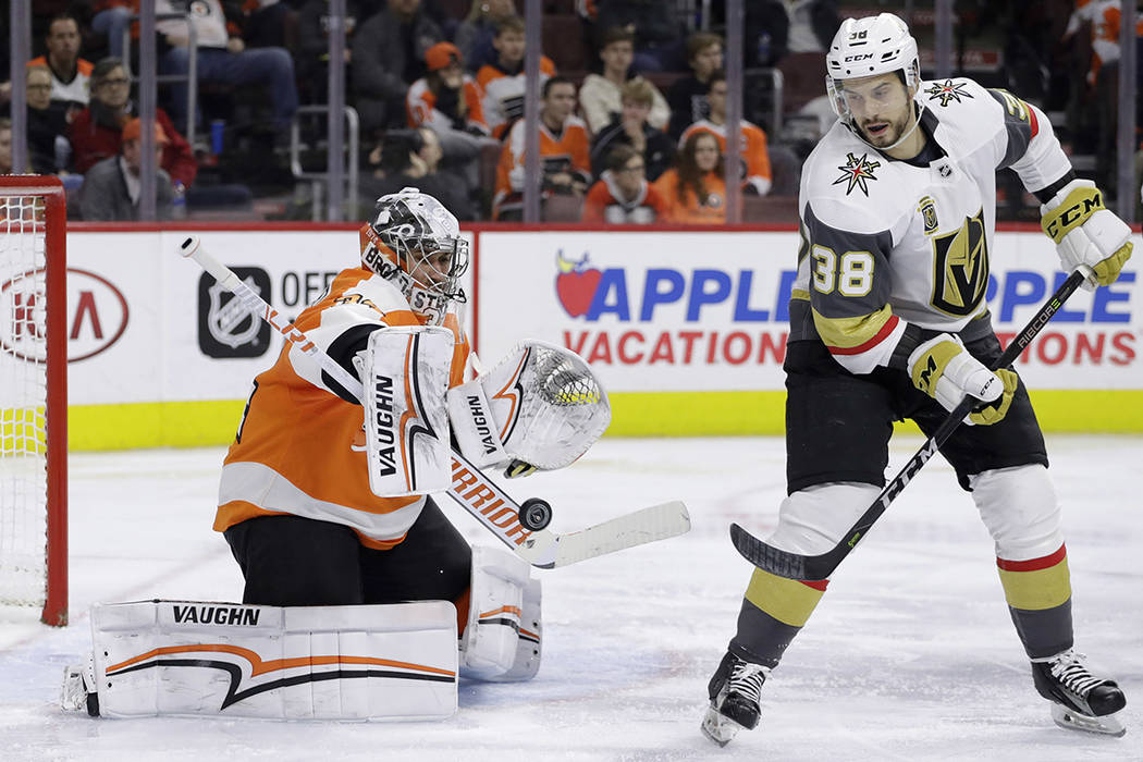 Philadelphia Flyers' Petr Mrazek, left, blocks a shot as Vegas Golden Knights' Tomas Hyka looks on during the third period of an NHL hockey game, Monday, March 12, 2018, in Philadelphia. (AP Photo ...