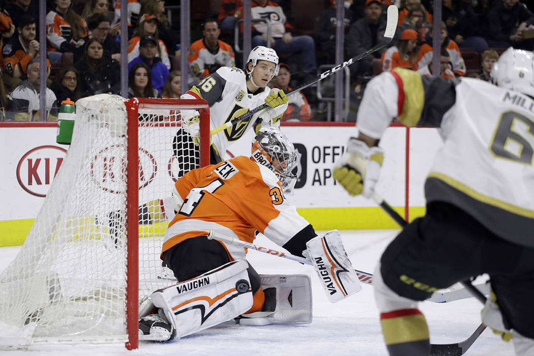 Philadelphia Flyers' Petr Mrazek, center, cannot block a goal by Vegas Golden Knights' Erik Haula, left, as Colin Miller looks on during the first period of an NHL hockey game, Monday, March 12, 2 ...