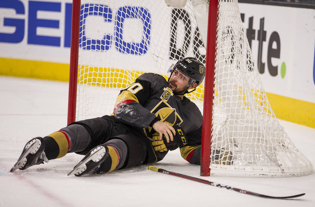 Vegas Golden Knights left wing Tomas Tatar (90) looks up from the goal after being hit by Ottawa Senators center Matt Duchene during the third period of an NHL hockey game Friday, March 2, 2018, i ...