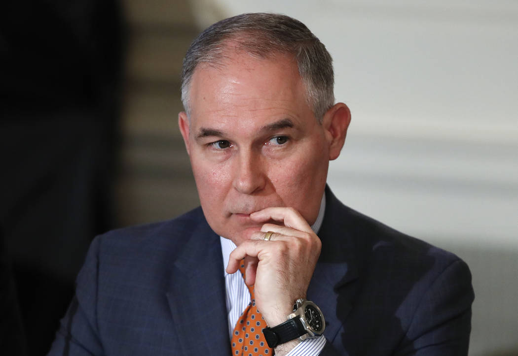 In this Feb. 12, 2018 photo, Environmental Protection Agency Administrator Scott Pruitt attends a meeting with state and local officials and President Donald Trump about infrastructure in the Stat ...