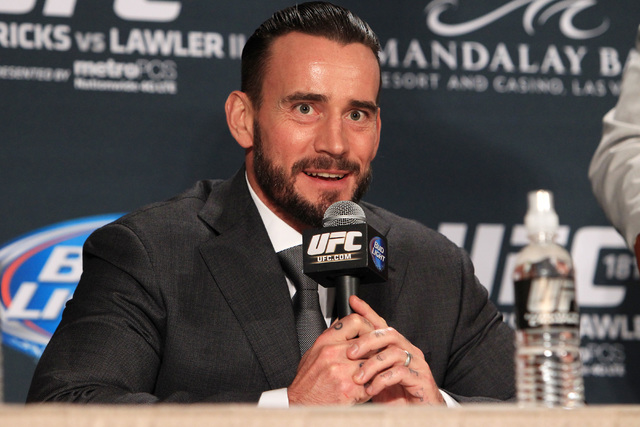 Former WWE professional wrestler CM Punk speaks at a press conference following UFC 181 after signing a contract with the UFC Saturday, Dec. 6, 2014 at the Mandalay Bay Events Center.  (Sam Morris ...