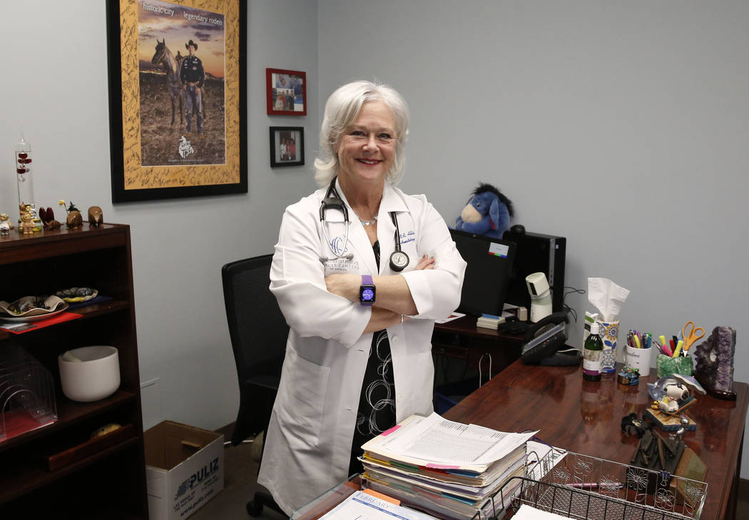 Dr. Mary Ann Allison, an oncologist with the Comprehensive Cancer Centers of Nevada, poses for a photo at her office at the Comprehensive Cancer Centers of Nevada on Thursday, March 15, 2018, in H ...
