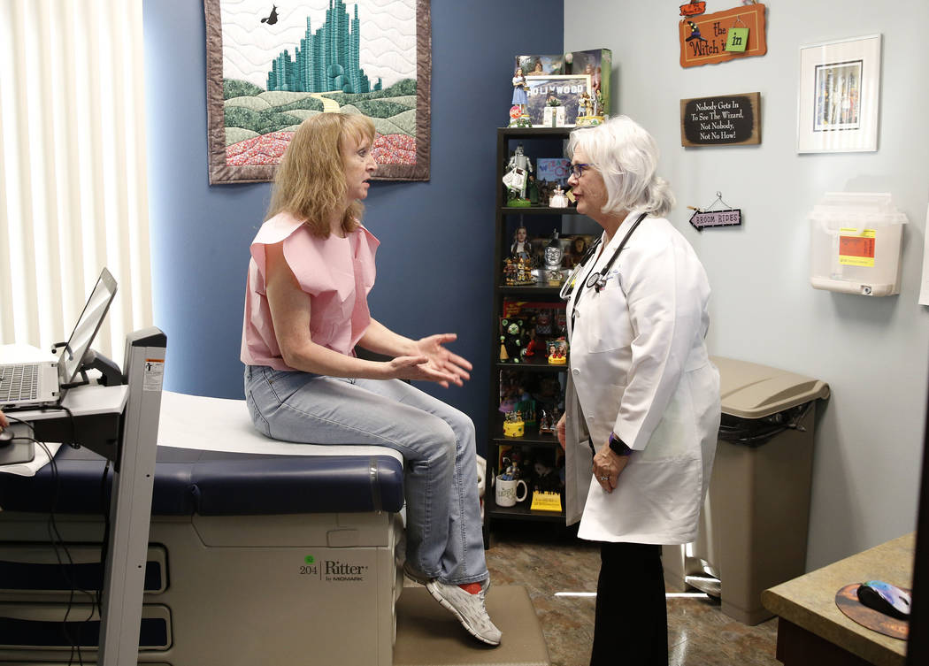 Dr. Mary Ann Allison, an oncologist with the Comprehensive Cancer Centers of Nevada, listens to her patient, Mary Baer, at the Comprehensive Cancer Centers of Nevada on Thursday, March 15, 2018, i ...