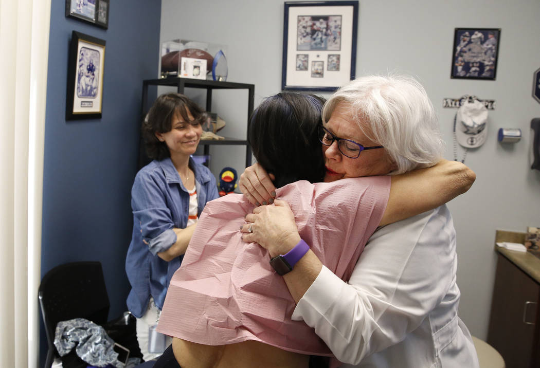 Sonia Roldan, 75, left, hugs Dr. Mary Ann Allison, an oncologist with the Comprehensive Cancer Centers of Nevada, after being examined on Thursday, March 15, 2018, in Henderson as Roldan's daughte ...