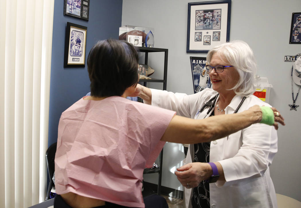 Sonia Roldan, 75, left, hugs Dr. Mary Ann Allison, an oncologist with the Comprehensive Cancer Centers of Nevada, after being examined on Thursday, March 15, 2018, in Henderson. Bizuayehu Tesfaye/ ...