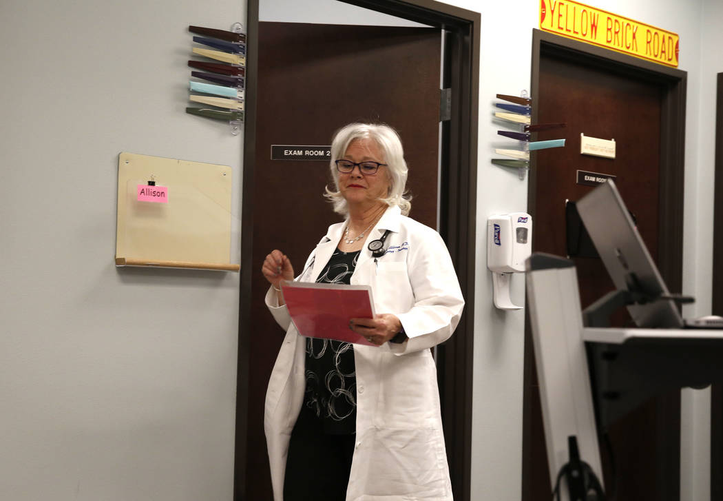Dr. Mary Ann Allison, an oncologist with the Comprehensive Cancer Centers of Nevada, exits an exam room after seeing her patient at the centers on Thursday, March 15, 2018, in Henderson. Bizuayehu ...