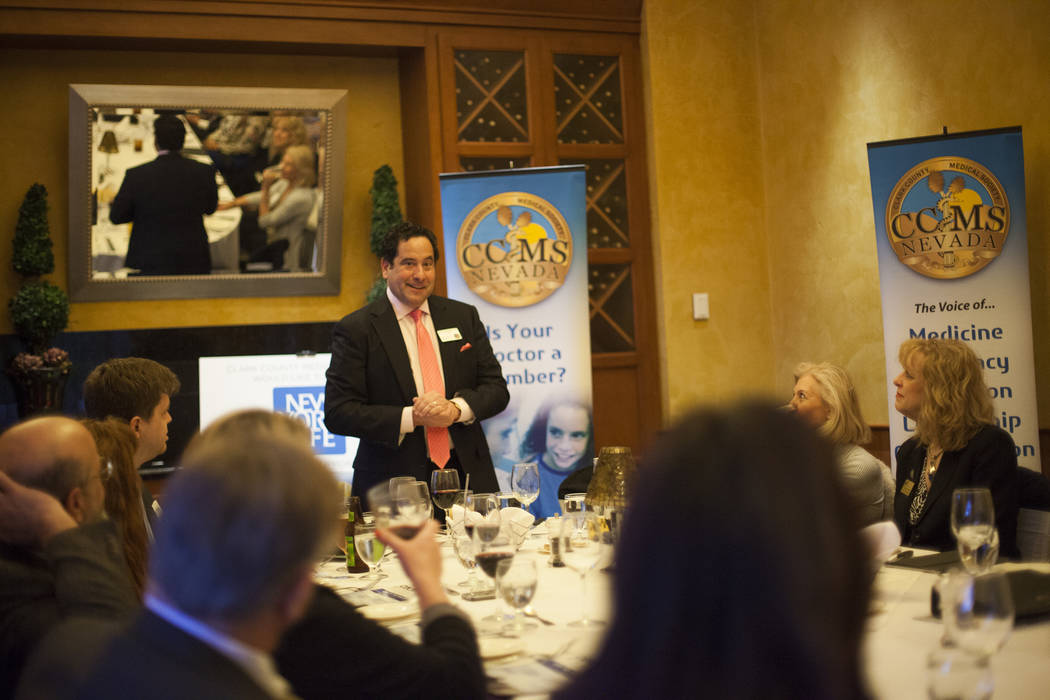 Dr. Joseph Adashek speaks to the crowd over dinner at the JW Marriot in Las Vegas, Wednesday, March 21, 2018. The Clark County Medical Center hosted a dinner to close out the MiniMed Internship pr ...