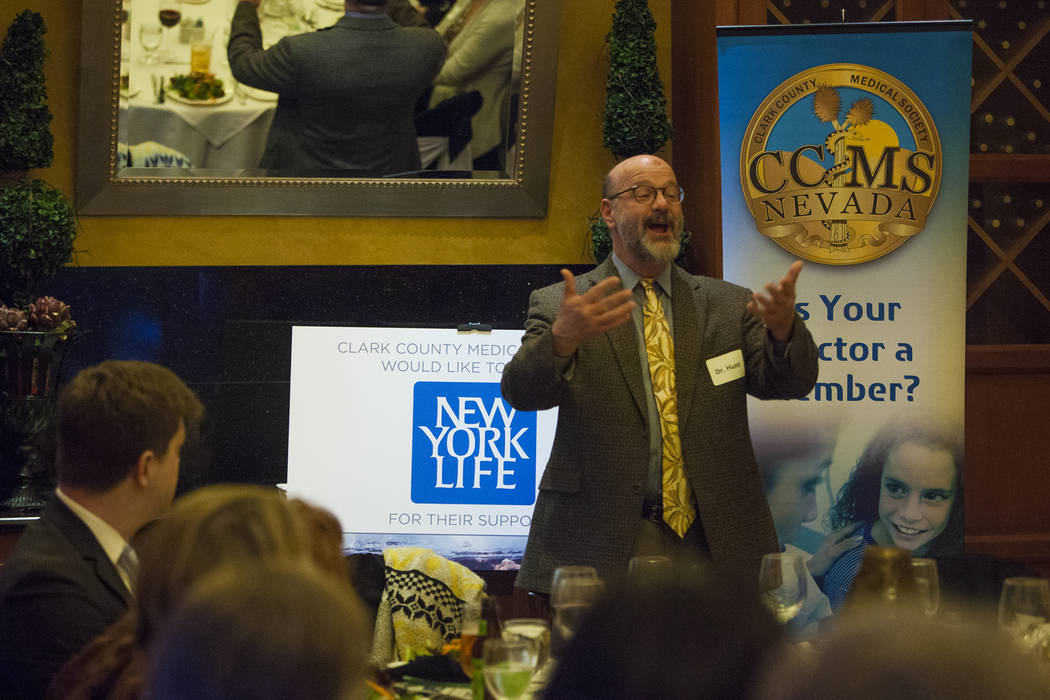 Dr. Tom Hunt speaks to the crowd over dinner at the JW Marriot in Las Vegas, Wednesday, March 21, 2018. The Clark County Medical Center hosted a dinner to close out the MiniMed Internship program  ...