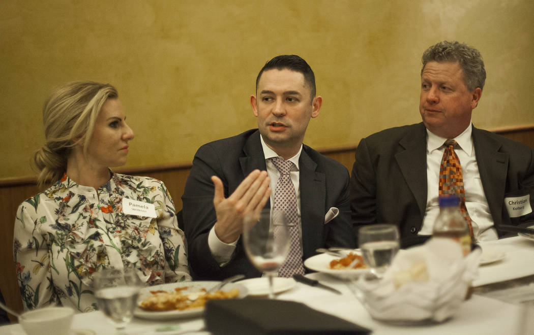 James Stirratt, center, speaks about his experience shadowing a doctor over dinner at the JW Marriot in Las Vegas, Wednesday, March 21, 2018, as Pamela Wilkins and Christian Kolberg look on. The C ...