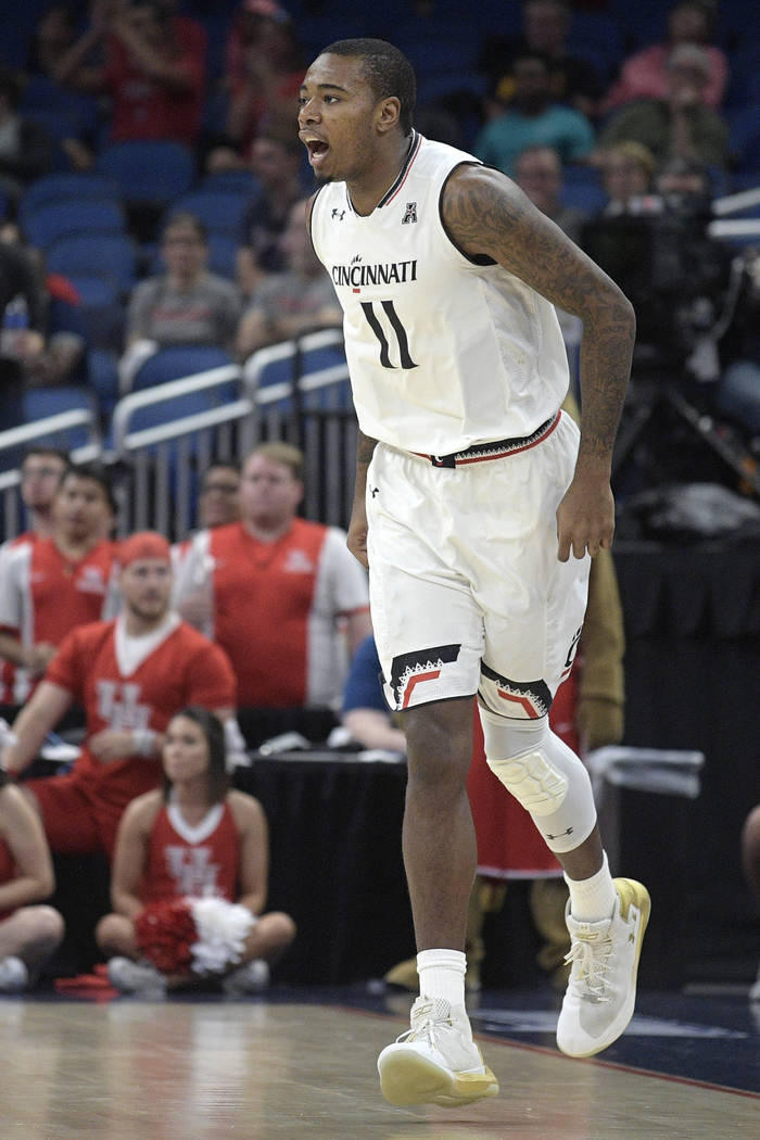 Cincinnati forward Gary Clark (11) celebrates after scoring a three-point basket during the first half of an NCAA college basketball championship game against Houston at the American Athletic Conf ...