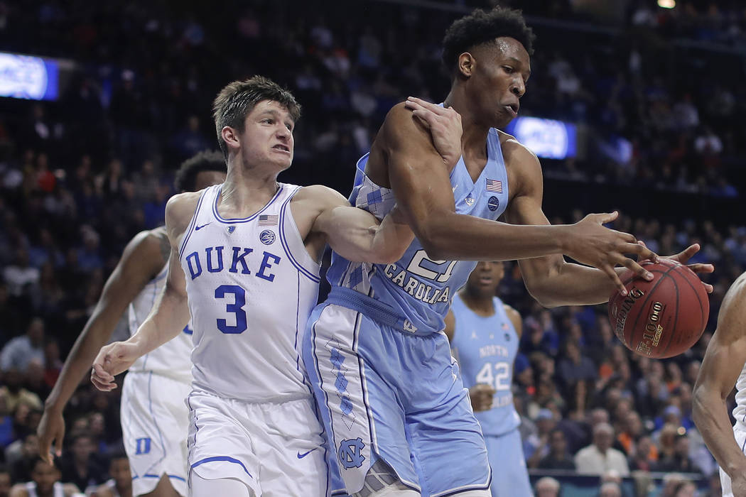 Duke guard Grayson Allen (3) and North Carolina forward Sterling Manley (21) compete for a rebound during the first half of an NCAA college basketball game in the Atlantic Coast Conference men's t ...