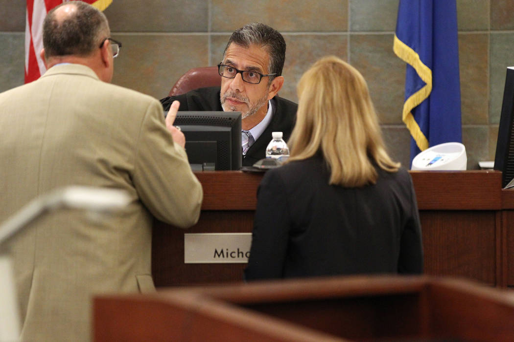 District Judge Michael Villani, center, talks to Deputy Public Defender Bryan Cox, left, and Deputy District Attorney Karen Mishler during sentencing for disbarred Las Vegas lawyer Easton Harris a ...