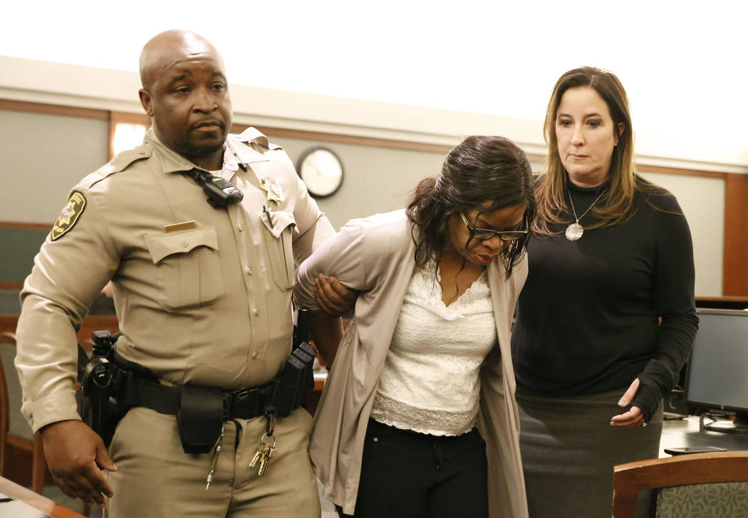 Janet Solander, center, accused of abusing her adopted children, is handcuffed and led out of the courtroom at the Regional Justice Center on Tuesday, March 13, 2018, in Las Vegas. At right her de ...