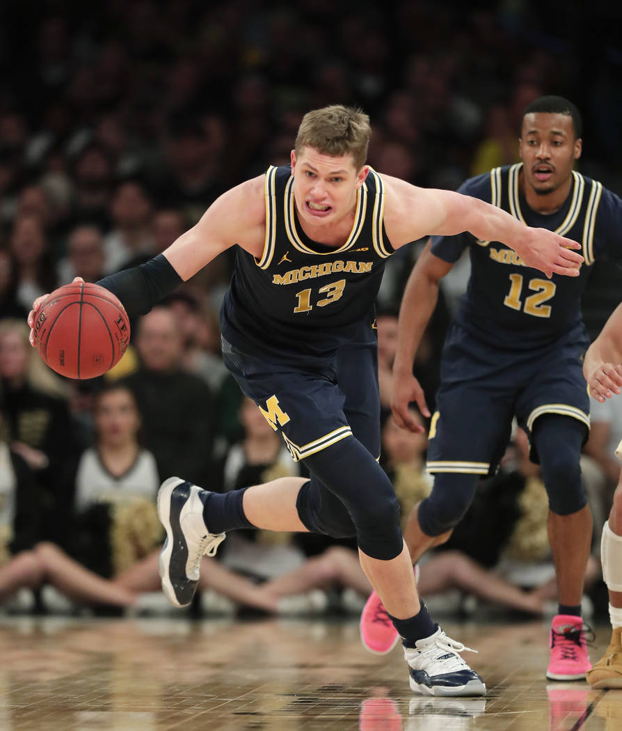 Michigan forward Moritz Wagner (13) makes a steal against Purdue during the second half of the NCAA Big Ten Conference tournament championship college basketball game, Sunday, March 4, 2018, in Ne ...