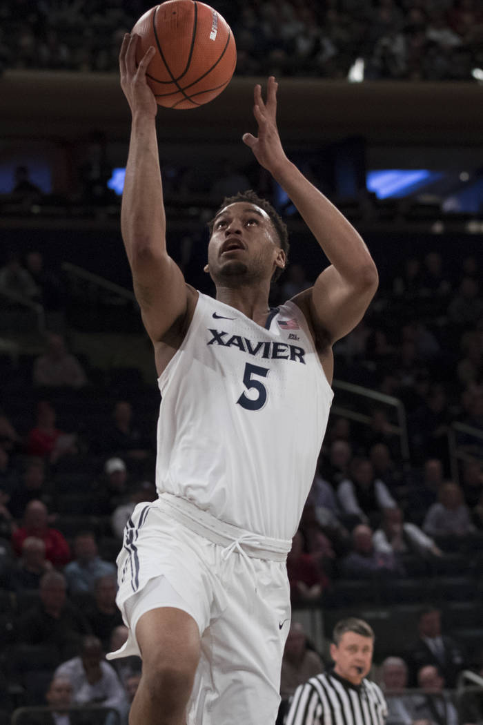 Xavier guard Trevon Bluiett goes to the basket during the first half of an NCAA college basketball game against St. John's in the quarterfinals of the Big East conference tournament, Thursday, Mar ...