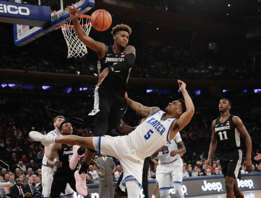 Providence's Nate Watson (0) defends against Xavier's Trevon Bluiett (5) during the first half of an NCAA college basketball game in the Big East men's tournament semifinals Friday, March 9, 2018, ...