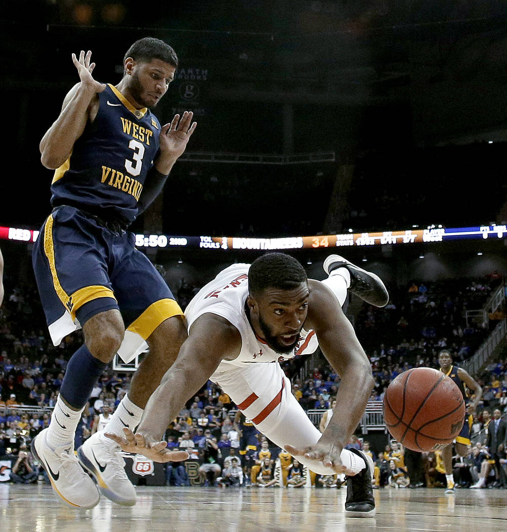 Texas Tech's Niem Stevenson and West Virginia's James Bolden (3) chase a long pass during the second half of an NCAA college basketball game in the Big 12 men's tournament Friday, March 9, 2018, i ...