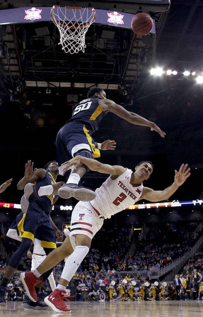 West Virginia's Sagaba Konate (50) blocks a shot by Texas Tech's Zhaire Smith (2) during the second half of an NCAA college basketball game in the Big 12 men's tournament Friday, March 9, 2018, in ...