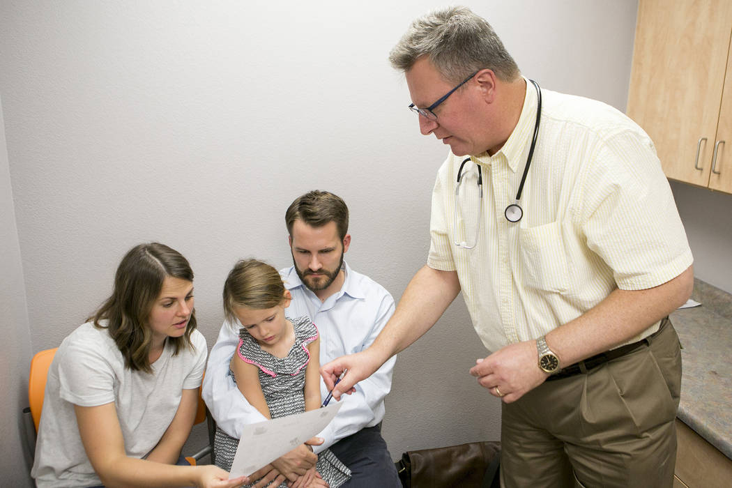 Dr. Howard Baron, right, meets with patient Stella Blodgett, 5, and her parents on Friday, June 23, 2017, in Las Vegas. Baron is among the approximately 79 percent of Nevada providers who accept n ...