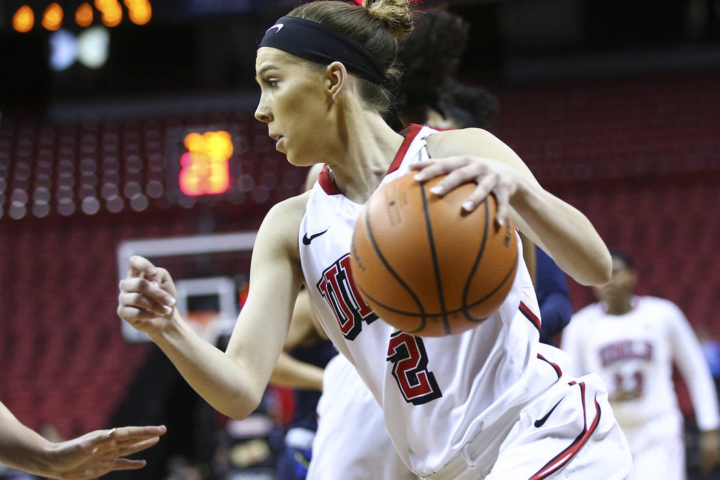 UNLV Lady Rebels guard Brooke Johnson (2) drives against the UNR Wolf Pack during the first half of a basketball game in the Mountain West tournament quarterfinals at the Thomas & Mack Center  ...