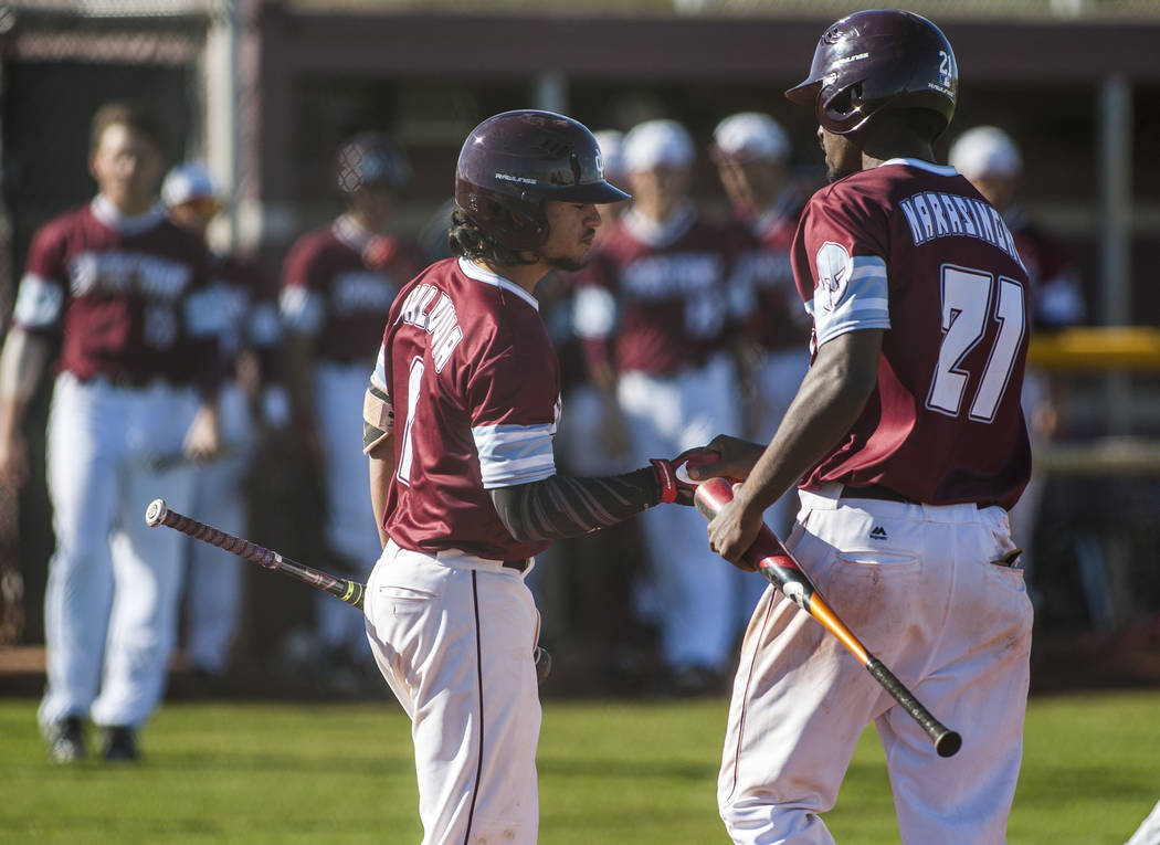 Cimarron-Memorial's Lasith Narasinghe celebrates with Daniel Valdivia after scoring against against Palo Verde at Cimarron-Memorial High School on Wednesday, March 14, 2018. Palo Verde won 12-8.   ...