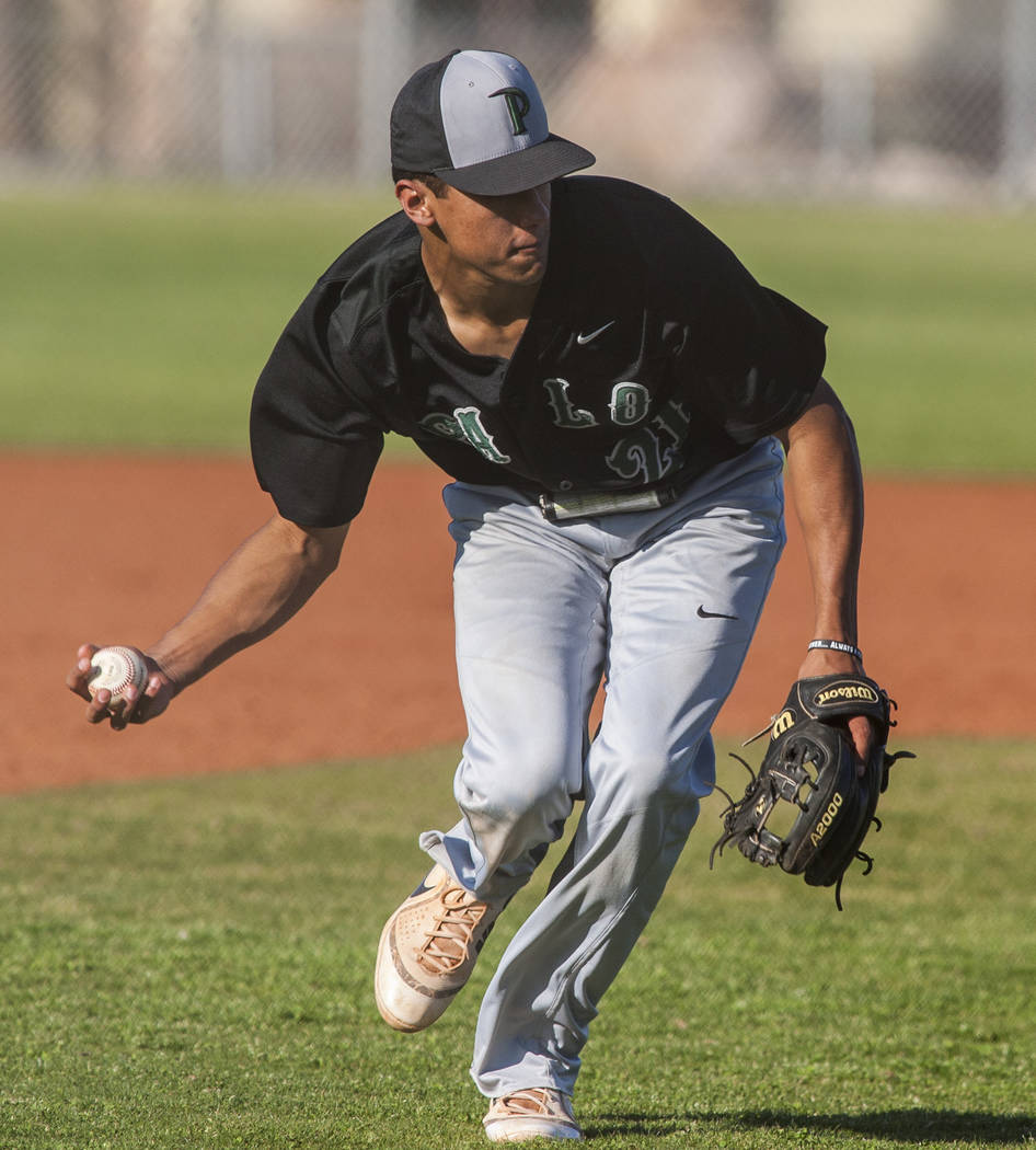 Palo Verde's Karsonne Winters scoops up a ball and looks to make a play against Cimarron-Memorial at Cimarron-Memorial High School on Wednesday, March 14, 2018. Palo Verde won 12-8.  Patrick Conno ...