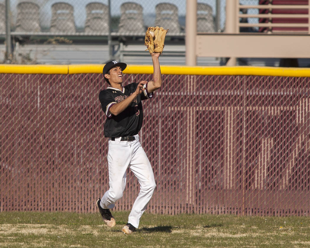 Faith Lutheran outfielder Jeremy Aguirre catches a pop fly while playing against Centennial during the top of the third inning at Faith Lutheran High School in Las Vegas on Thursday, March 15, 201 ...