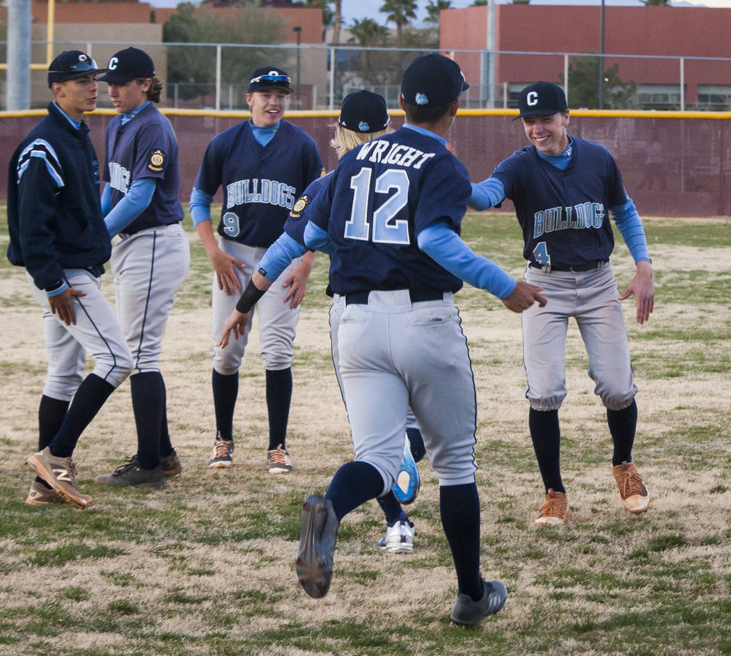 Centennial players celebrate after defeating Faith Lutheran 4-3 in the 10th inning at Faith Lutheran High School in Las Vegas on Thursday, March 15, 2018.  Patrick Connolly Las Vegas Review-Journa ...