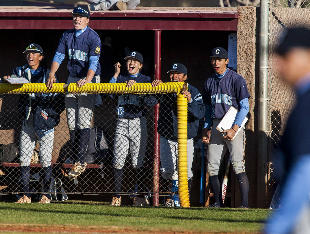 Centennial players react from the bench after scoring two runs in the top of the seventh inning with two outs while playing against Faith Lutheran at Faith Lutheran High School in Las Vegas on Thu ...