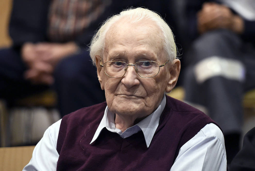 "Defendant Oskar Groening waits for the verdict of his trial at a court in Lueneburg, northern Germany on July 15, 2015. Groening, a former SS officer known as the ""Bookkeeper of Auschwitz"" was sen ..."
