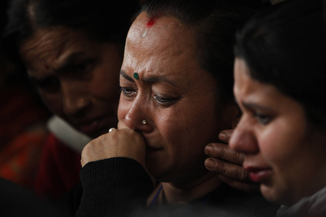 Unidentified family members of a passenger of a US-Bangla Flight BS211 mourn as they wait to receive his body outside government hospital in Kathmandu, Nepal, Tuesday, March 13, 2018AP Photo/Niran ...