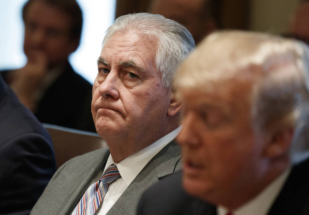 Secretary of State Rex Tillerson listens as President Donald Trump speaks during a cabinet meeting at the White House in Washington, Jan. 10, 2018. Tillerson is out as secretary of state. Presiden ...