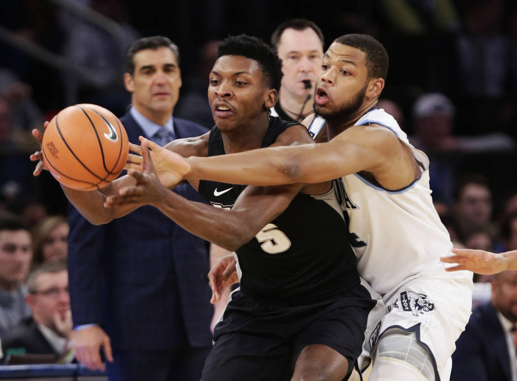 Villanova's Omari Spellman (14) defends against Providence's Rodney Bullock (5) during the first half of an NCAA college basketball game in the Big East men's tournament final Saturday, March 10,  ...