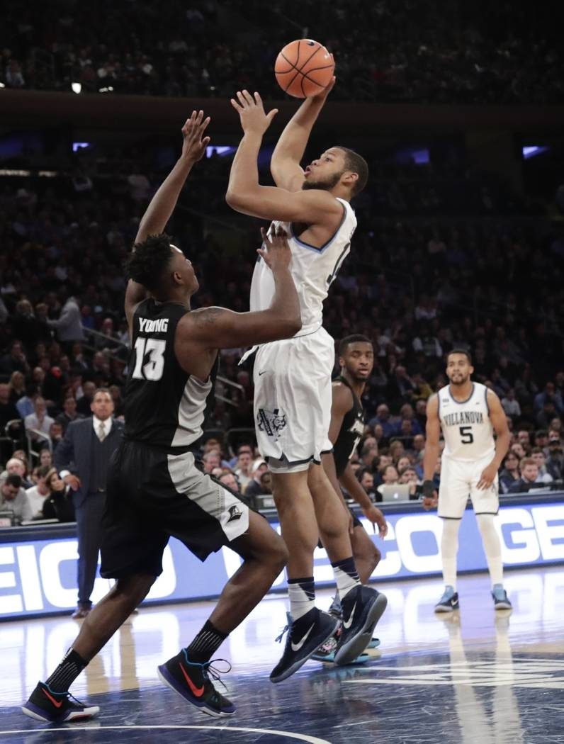 Villanova's Omari Spellman (14) shoots over Providence's Kalif Young (13) during the first half of an NCAA college basketball game in the Big East men's tournament final Saturday, March 10, 2018,  ...