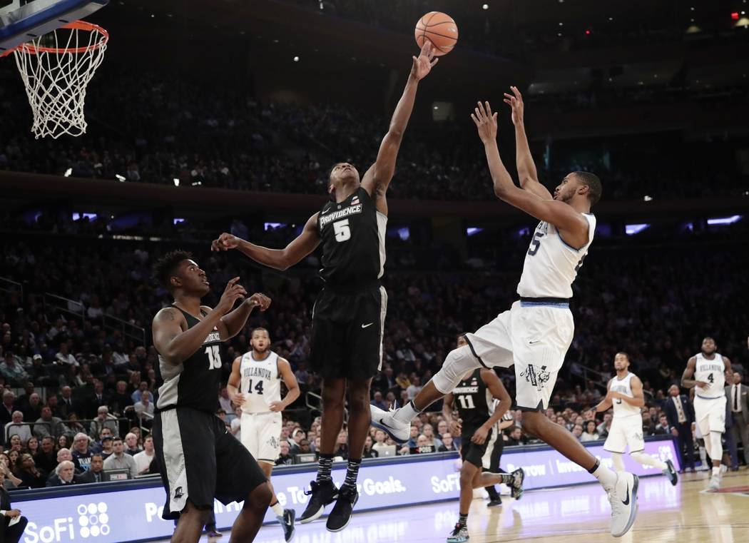 Villanova's Mikal Bridges (25) shoots over Providence's Rodney Bullock (5) during the first half of an NCAA college basketball game in the Big East men's tournament final Saturday, March 10, 2018, ...