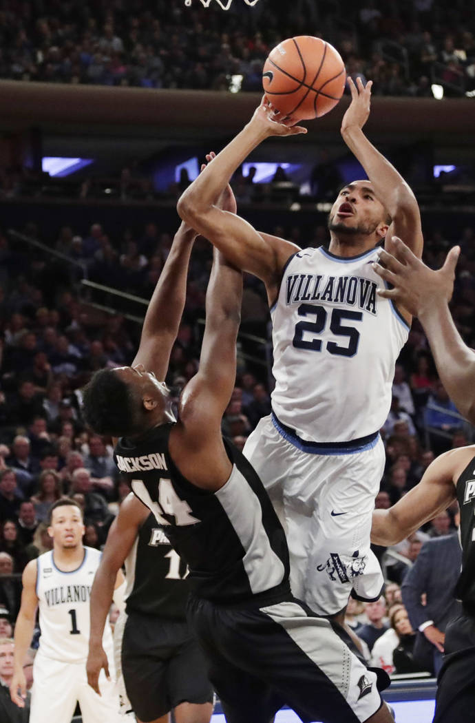 Villanova's Mikal Bridges (25) shoots over Providence's Isaiah Jackson (44) during the first half of an NCAA college basketball game in the Big East men's tournament final Saturday, March 10, 2018 ...