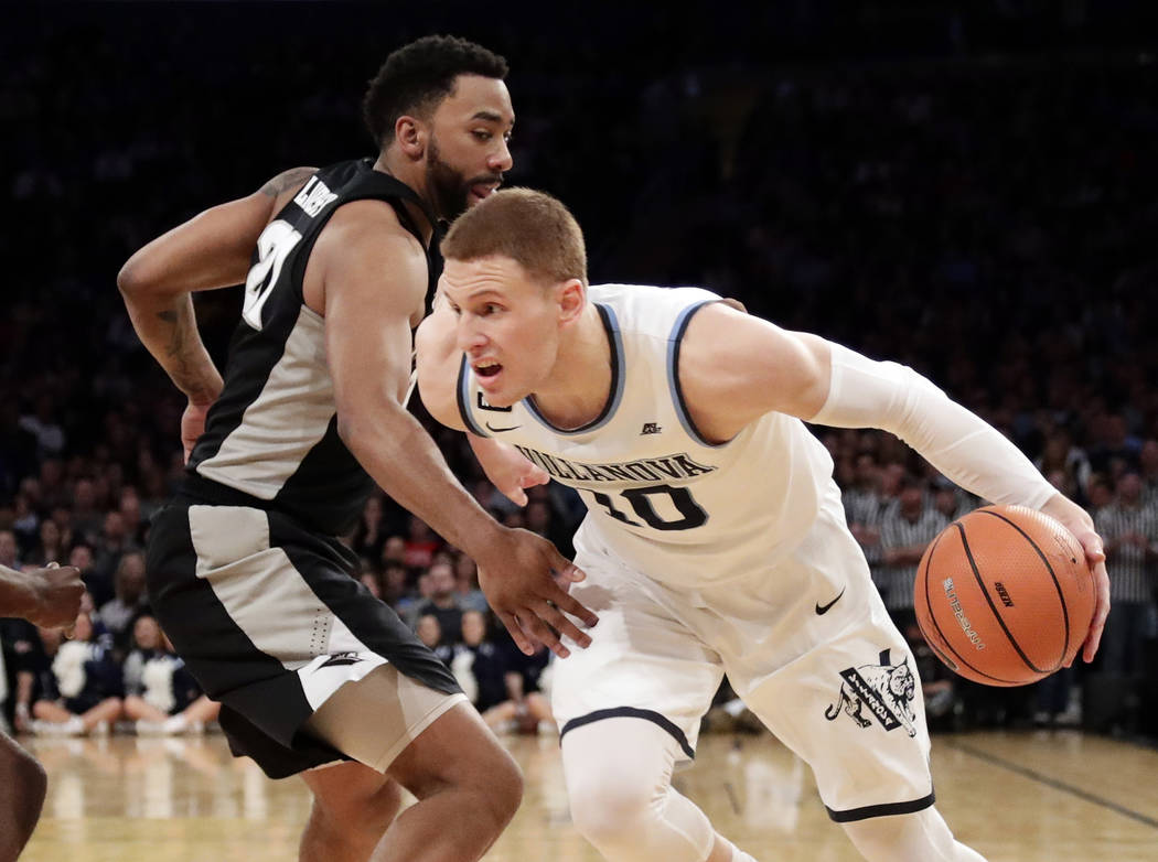 Villanova's Donte DiVincenzo (10) drives past Providence's Jalen Lindsey (21) during the first half of an NCAA college basketball game in the Big East men's tournament final Saturday, March 10, 20 ...