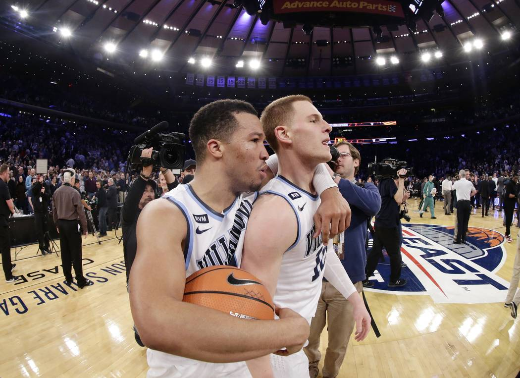 Villanova's Jalen Brunson, left, celebrates with Donte DiVincenzo after the team's NCAA college basketball game against Providence in the Big East men's tournament final Saturday, March 10, 2018,  ...