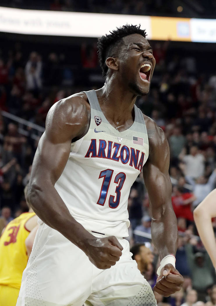 Arizona's Deandre Ayton reacts after a dunk against Southern California during the second half of an NCAA college basketball game for the Pac-12 men's tournament championship Saturday, March 10, 2 ...