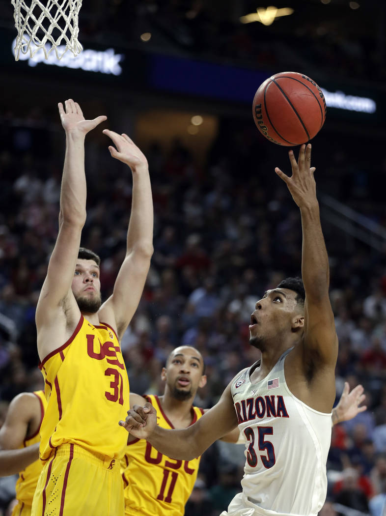 Arizona's Allonzo Trier shoots while Southern California's Nick Rakocevic defends during the second half of an NCAA college basketball game for the Pac-12 men's tournament championship Saturday, M ...