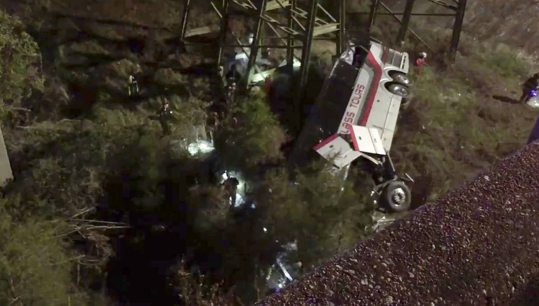 This photo provided by Jesus Tejada shows first responders searching around a bus that plunged into a ravine, Tuesday, March 13, 2018 on Interstate 10, Loxley, Ala.  Several people were on board,  ...