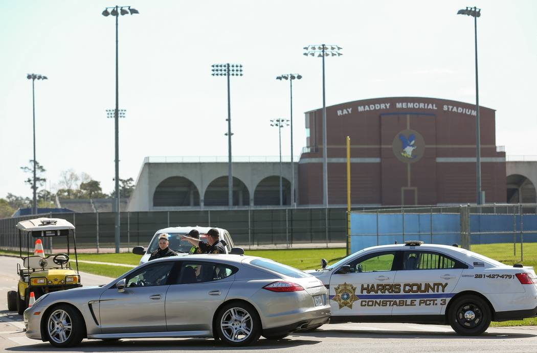 Harris County Precinct 3 Constable's Office deputies guide traffic into Channelview High School on the intersection of Crockett and Sheldon roads Tuesday, March 13, 2018, in Channelview, Texas. St ...
