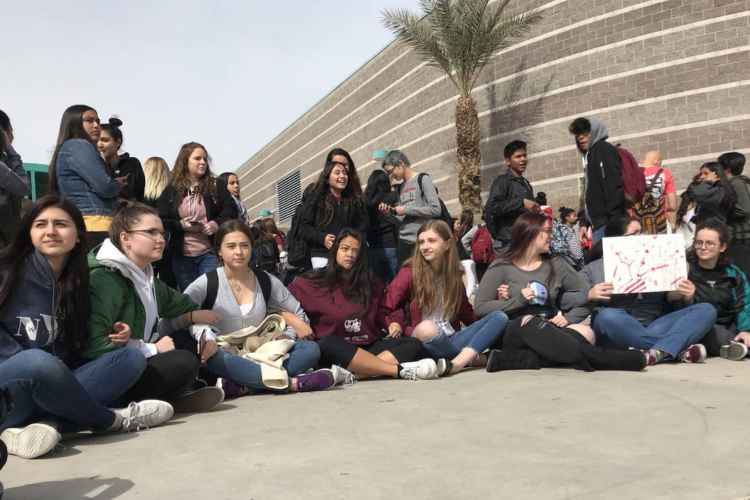 Students at Silverado High School walked out of the building for 17 minutes on Wednesday calling for gun control.  Credit: @cateiguess/Twitter
