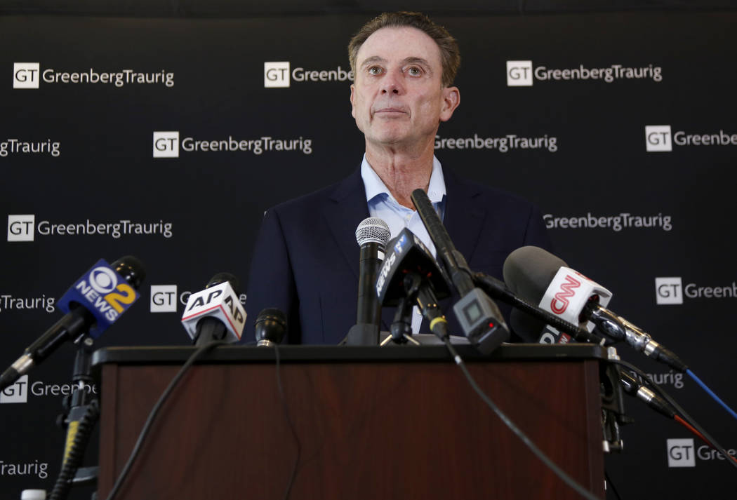 Former Louisville basketball coach Rick Pitino talks to reporters during a news conference in New York, Wednesday, Feb. 21, 2018. Pitino held the news conference in the wake of an NCAA decision in ...