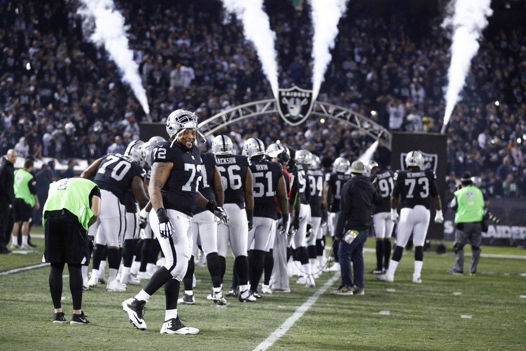 Oakland Raiders offensive tackle Donald Penn (72) smiles after he is introduced on the field prior to the team's game against the Dallas Cowboys in Oakland, Calif., Sunday, Dec. 17, 2017. Heidi Fa ...