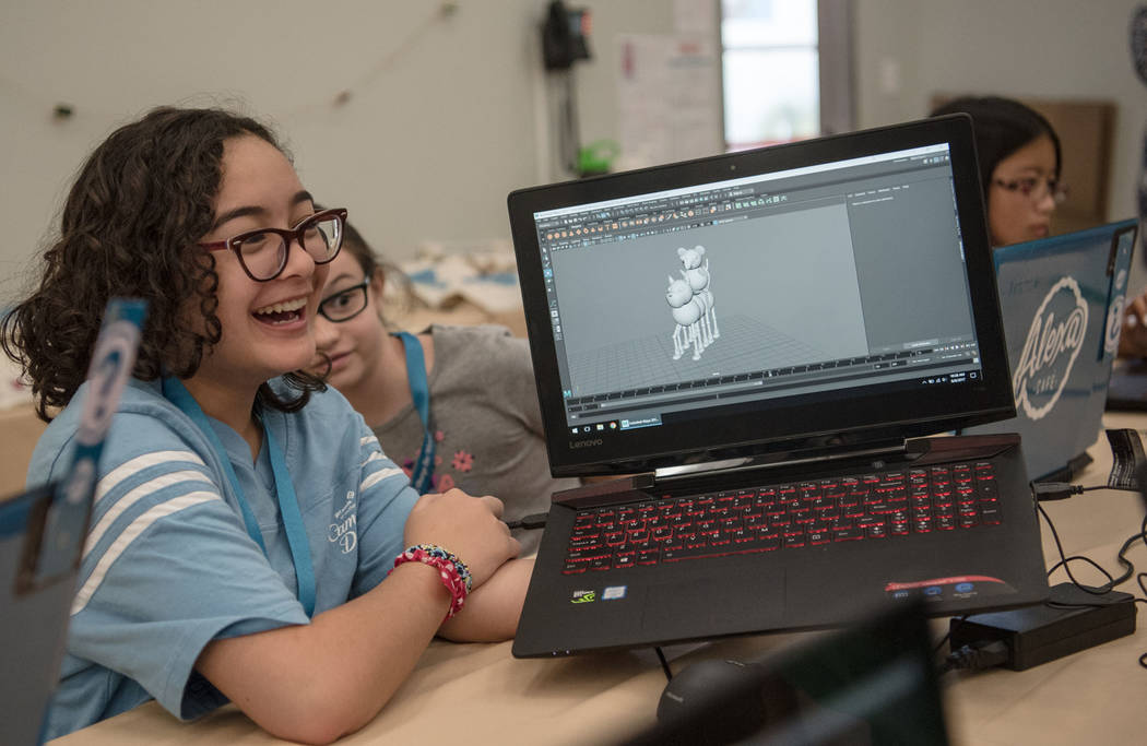 Athena, 13, jokes with other camp members about her 3-D model character during Alexa Cafe, an all-girls tech camp, at the Girl Scouts of Southern Nevada on Tuesday, Aug. 8, 2017, in Las Vegas. (Mo ...
